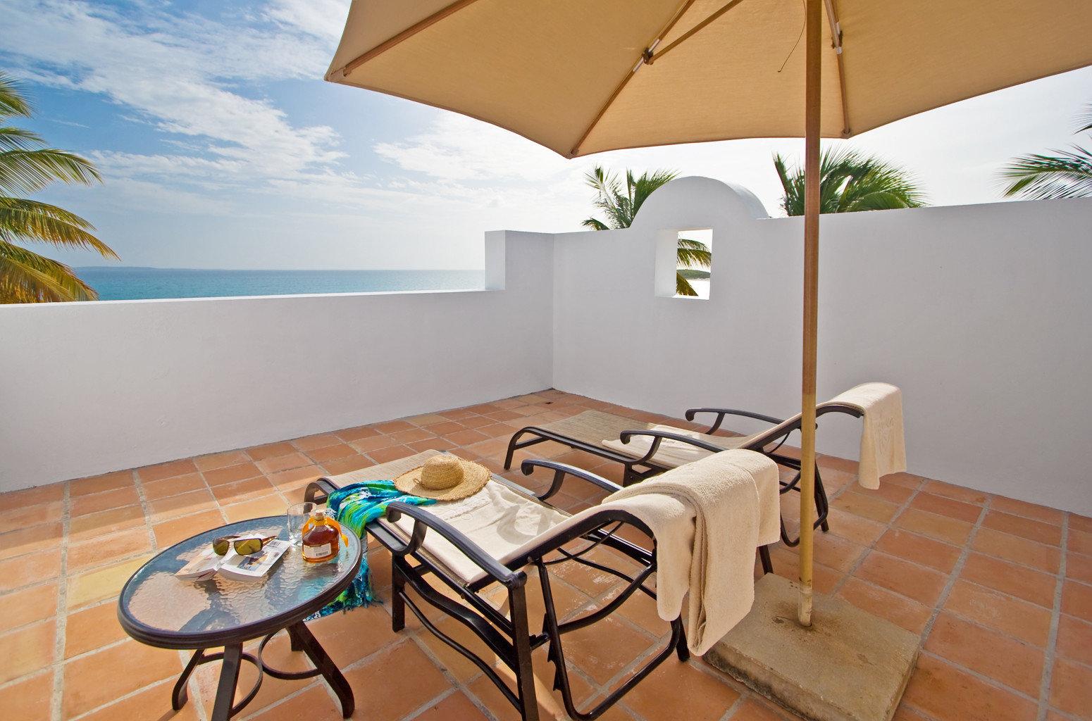 Beach Beachfront Lounge Ocean chair property Villa house cottage home Resort condominium farmhouse hacienda