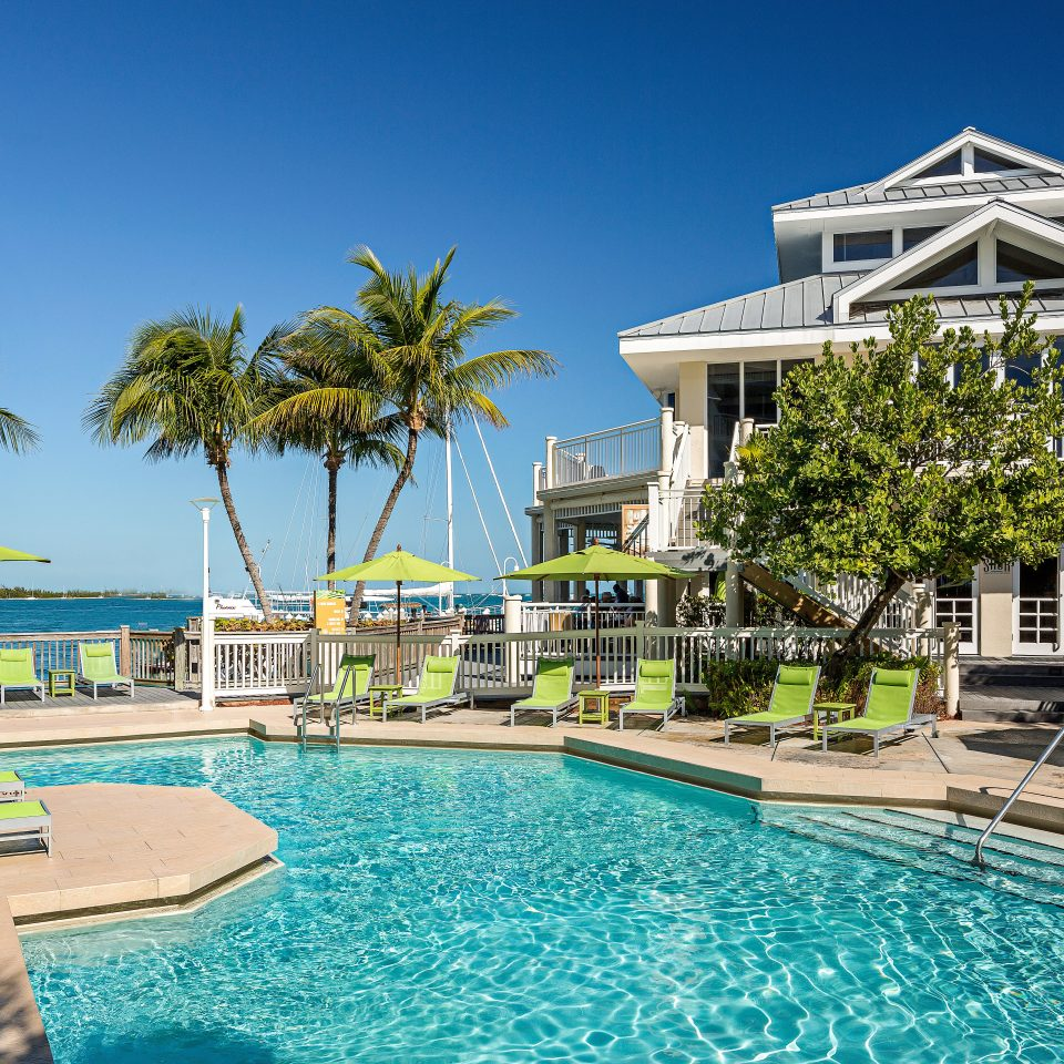 Beach Beachfront Lounge Ocean Pool water Resort sky swimming pool property leisure condominium swimming caribbean home resort town Villa mansion