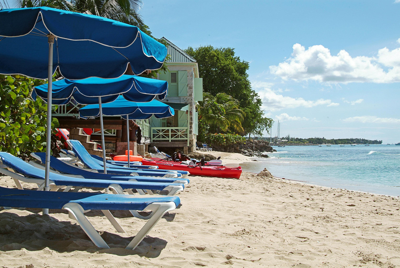 Beach Beachfront Lounge Ocean sky ground leisure chair Sea sand Water park lawn Resort vehicle sandy shore shade day