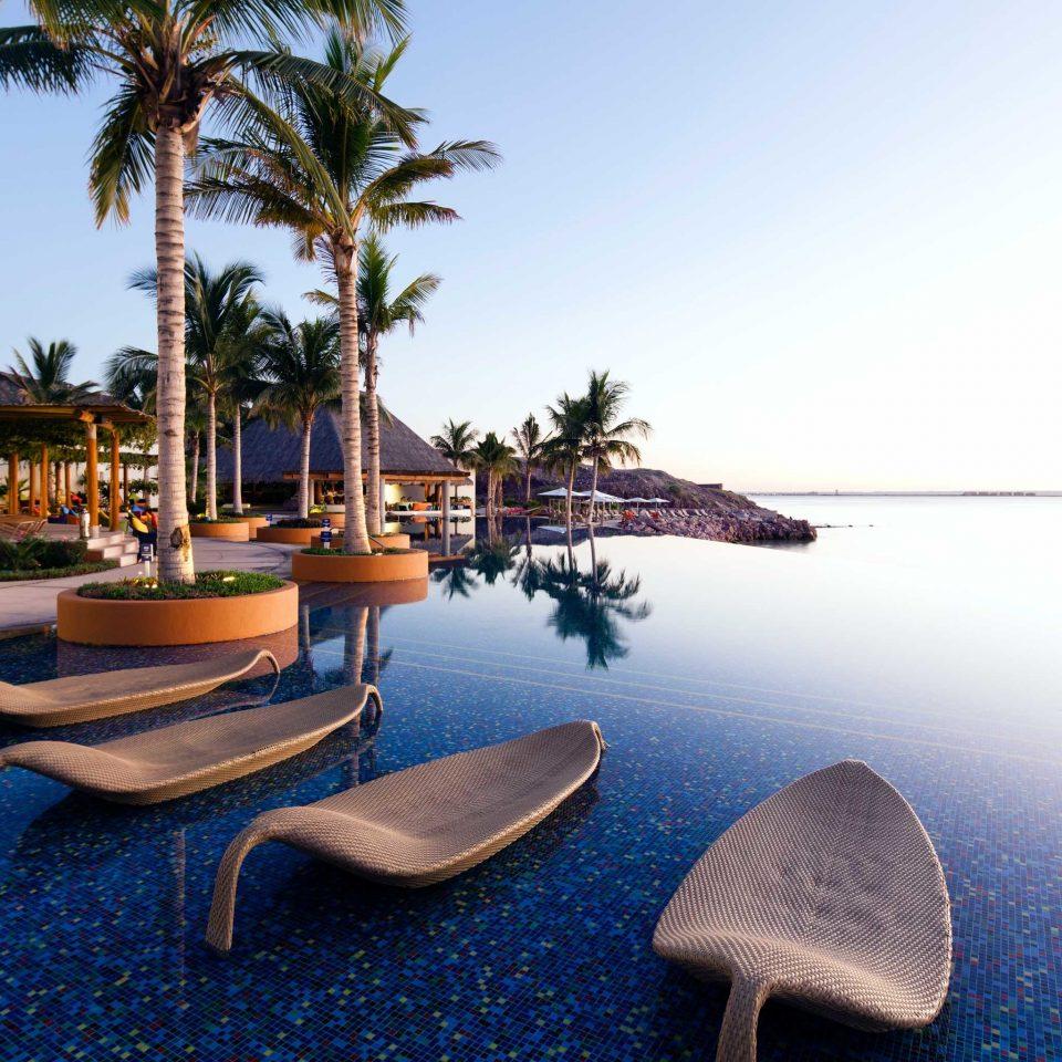 Beach Beachfront Lounge Pool Romantic Tropical sky leisure Resort Sea swimming pool palm dock marina shore