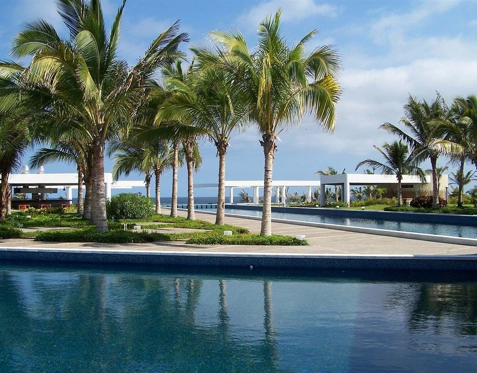 Beachfront Lounge Pool Ranch Tropical sky tree palm property swimming pool Resort arecales Beach Sea Villa palm family condominium tropics plant empty shore