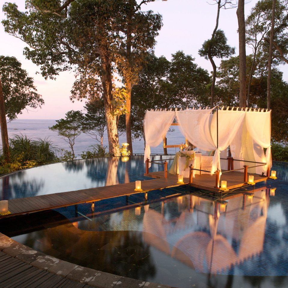 Beach Beachfront Luxury Nightlife Romance Romantic Waterfront tree sky swimming pool water Resort park traveling