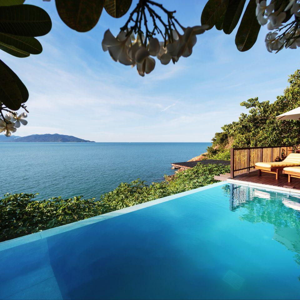 Beach Beachfront Luxury Ocean Pool Romantic tree sky water leisure swimming pool Resort Villa caribbean swimming