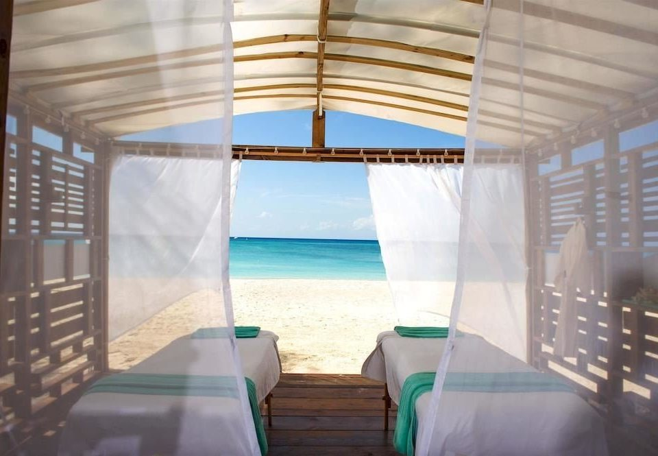 Beach Beachfront Luxury Romantic Spa chair property swimming pool