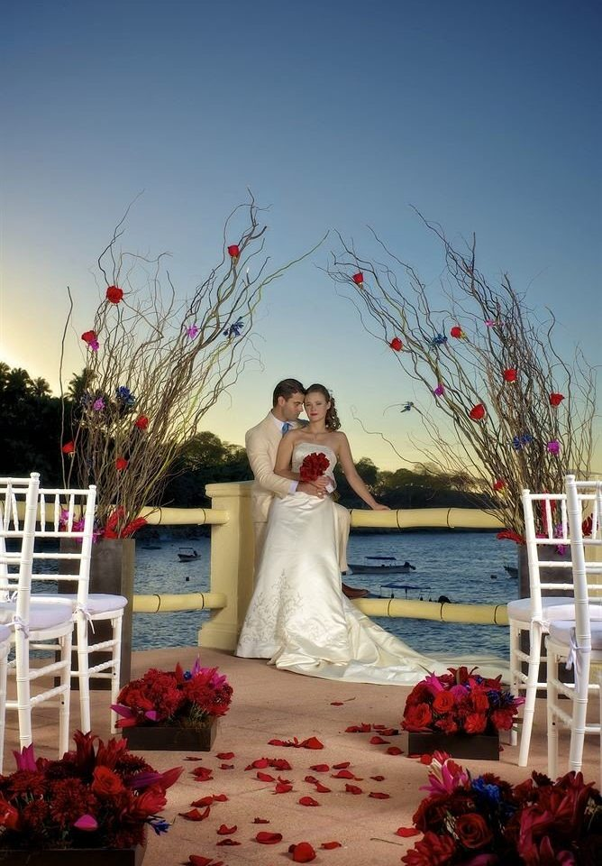 Beach Beachfront Ocean Romantic Scenic views photograph red bride flower wedding ceremony floristry spring