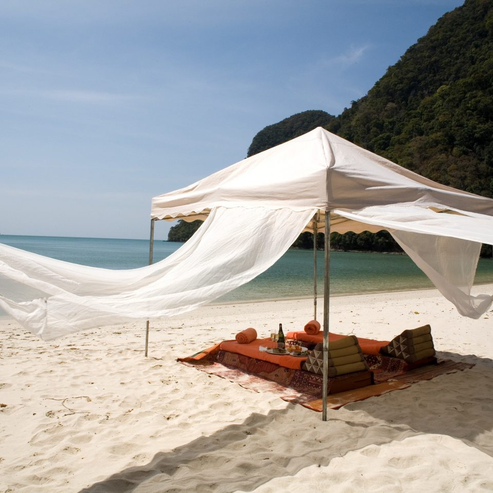 Beach Beachfront Ocean sky water tent Sea sand sandy shore day