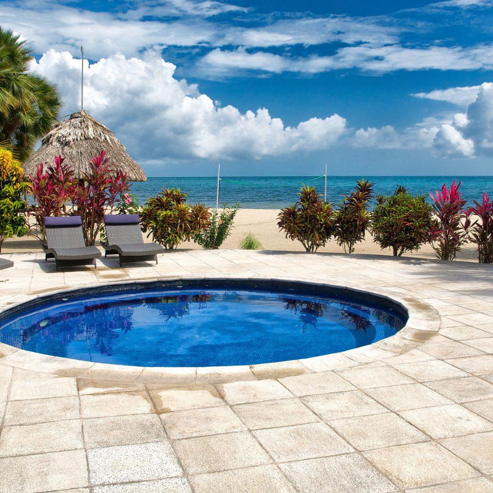 Beachfront Play Pool Resort Scenic views tree ground sky swimming pool property leisure Beach Villa backyard caribbean palm