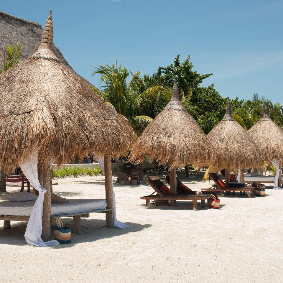 Beach Beachfront Secret Getaways Trip Ideas sky tree Resort arecales hut restaurant Village travel day