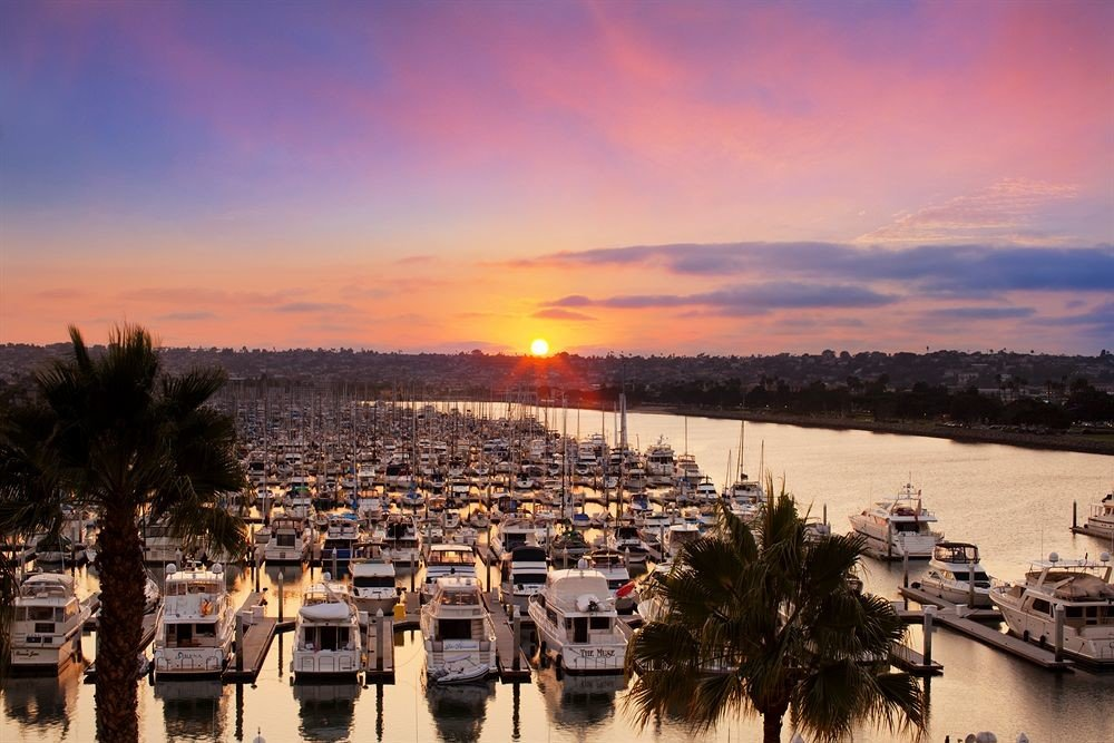 sky water Boat scene Sunset horizon evening Sea dusk morning dawn dock River sunrise Beach marina Coast cityscape Harbor docked