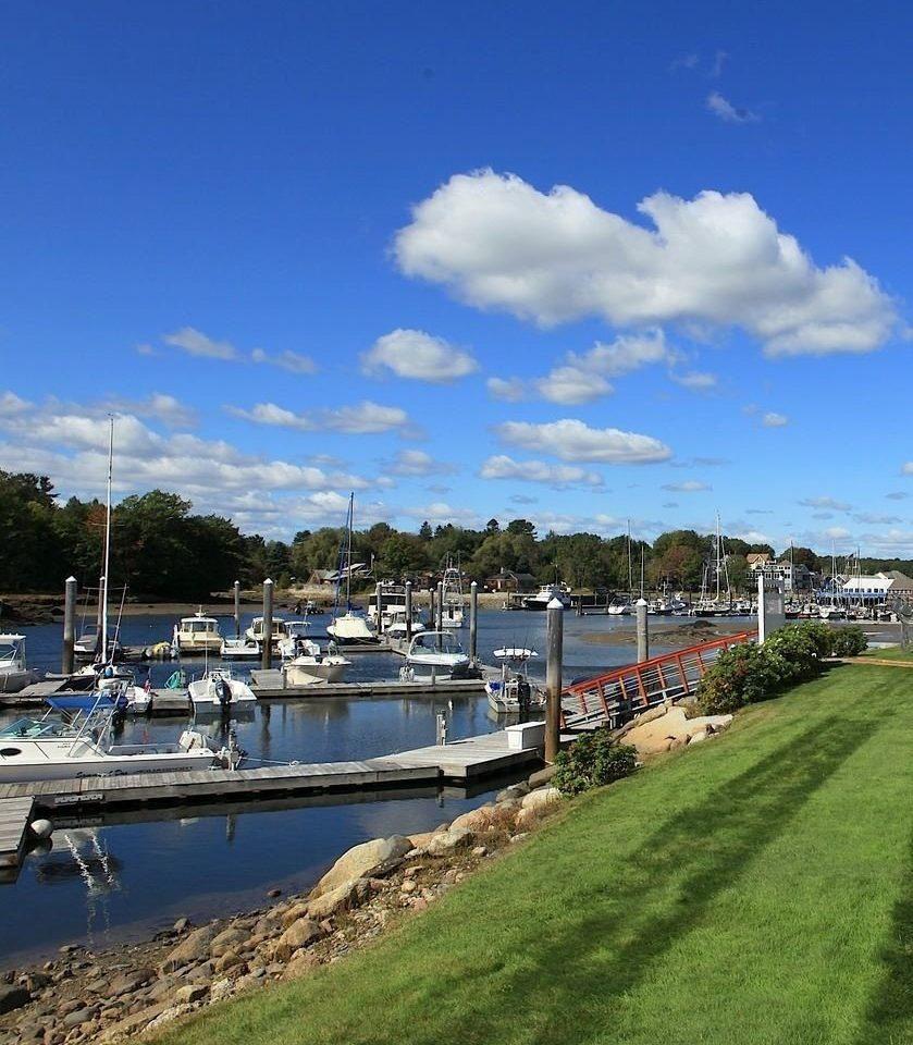 sky grass marina shore Sea dock Coast vehicle Harbor Boat waterway Beach