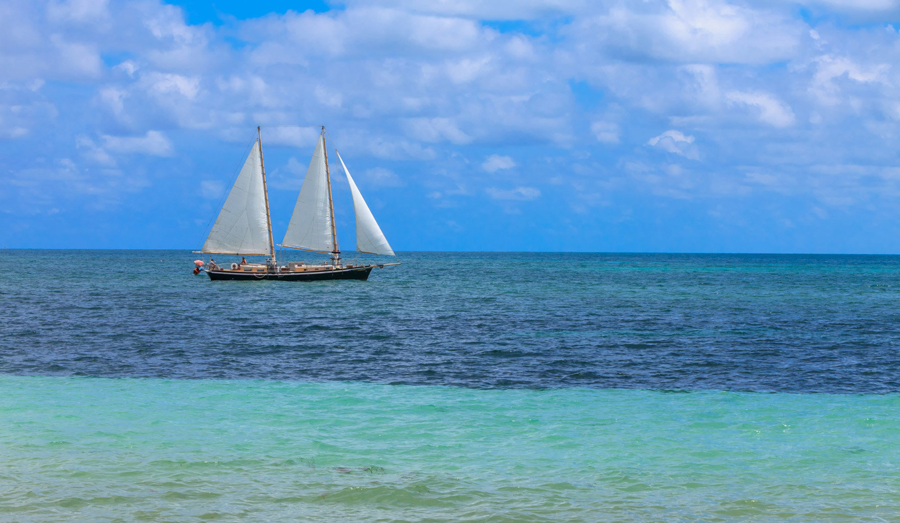 water sky Sea watercraft transport Boat Ocean sailing vessel sailboat vehicle horizon sail shore sailing wind wave Beach caribbean Coast wave sailing ship Island cape wind day distance