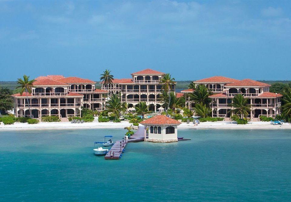 water sky Boat house Nature Town Sea Resort caribbean Beach Island Coast marina blue shore surrounded