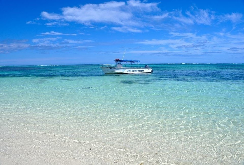 water sky Ocean Boat Sea Nature shore Beach caribbean horizon Coast blue wind wave vehicle Island sand wave cape islet cay Lagoon clear day sandy