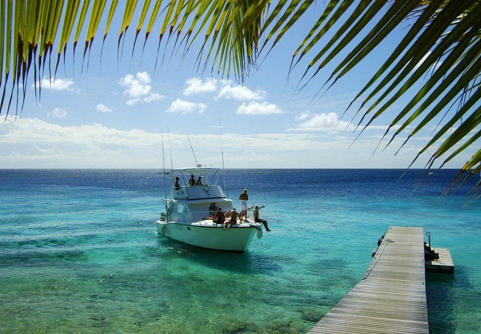 water sky Boat Sea caribbean Ocean tropics shore vehicle arecales Beach Island Lagoon Coast