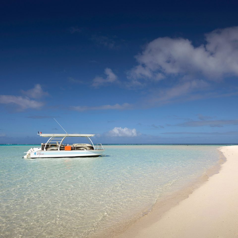sky water Boat Beach Sea shore horizon Ocean cloud caribbean Nature vehicle Coast sand Island Lagoon cape wave day distance