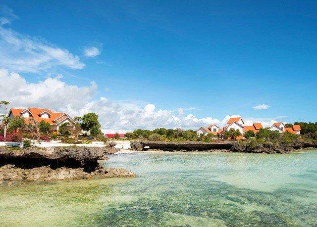 sky water shore Coast Sea Beach Nature Ocean cove caribbean islet Lagoon cape Island tropics Boat