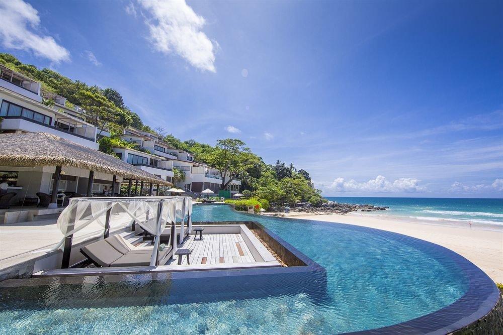 sky water swimming pool property Sea caribbean Ocean Resort Nature vehicle Coast Lagoon marina Villa yacht Beach passenger ship shore Boat