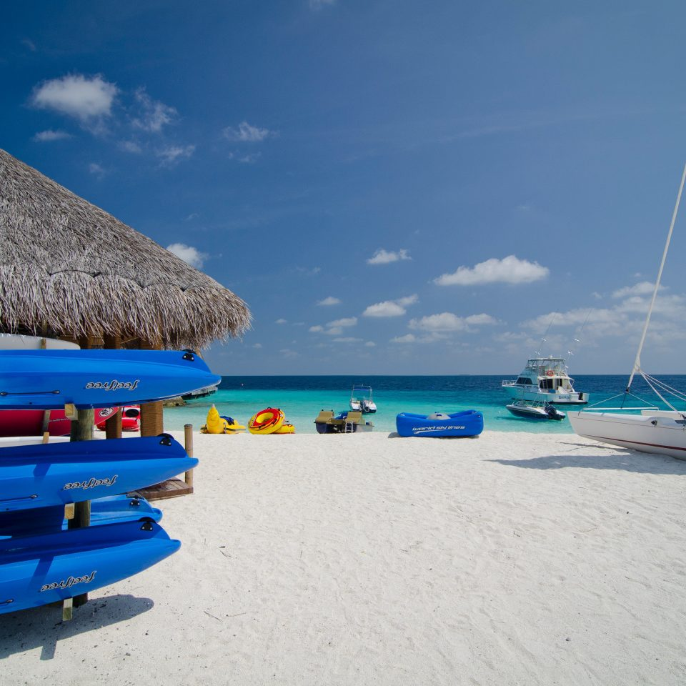 sky Beach Sea vehicle Boat Ocean sailing Coast blue caribbean passenger ship Lagoon sandy day