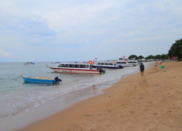 sky Beach Sea shore Nature vehicle Coast Boat boating sand sandy