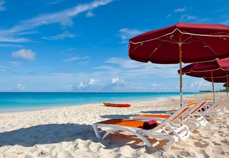 sky umbrella chair Beach water lawn leisure shore Sea Nature Ocean red Coast caribbean lined sandy shade day Boat