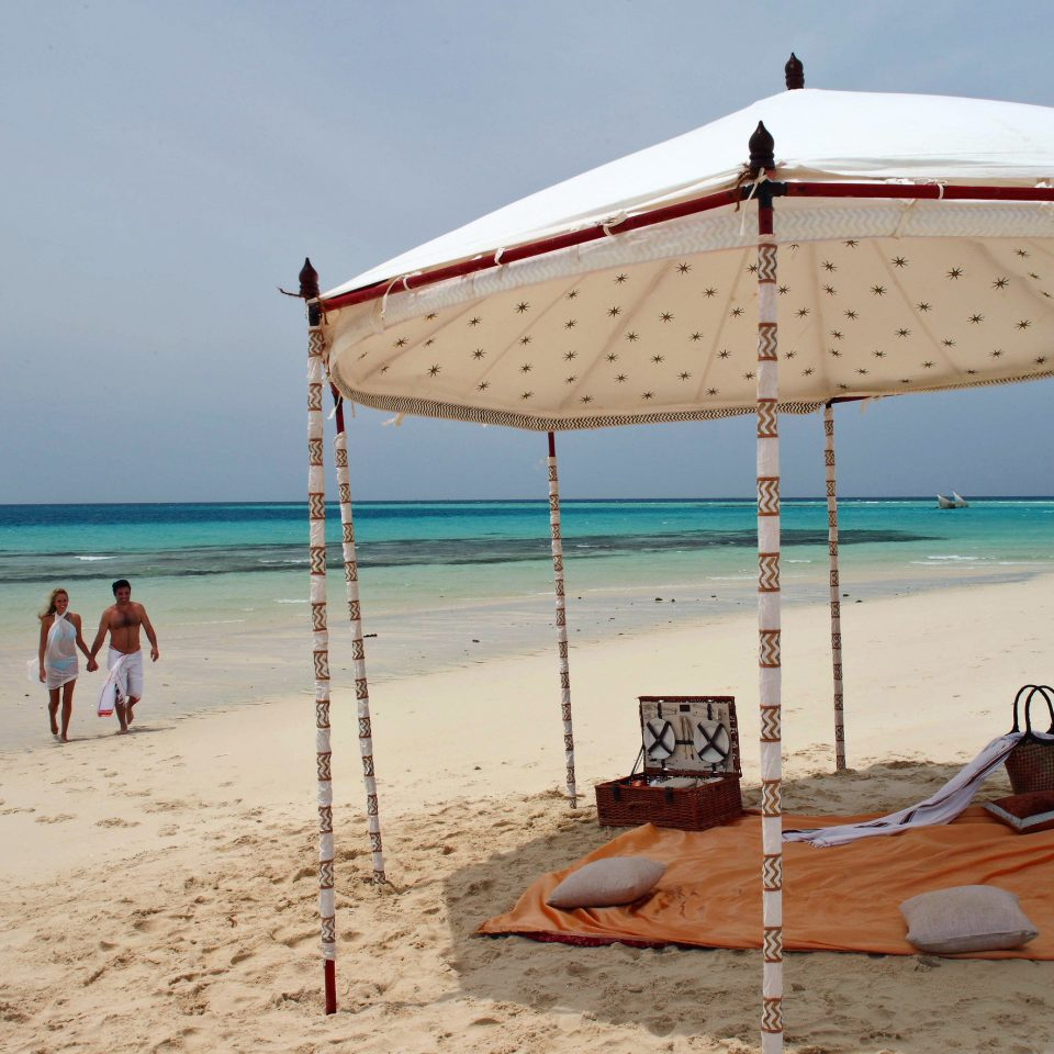 sky Beach Sea shore umbrella vehicle Ocean Nature Coast Boat sand accessory