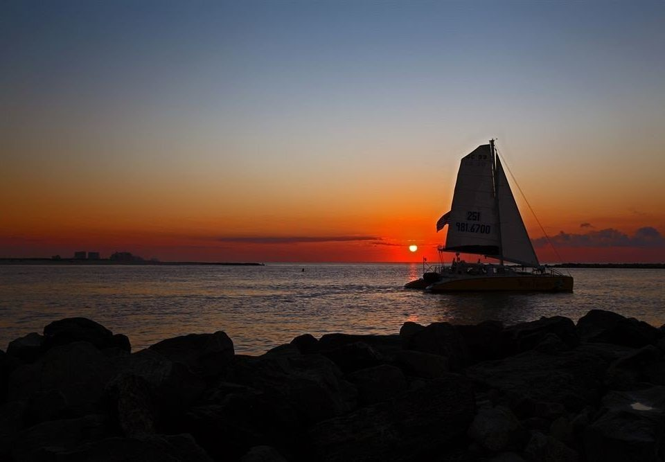 Boat Ocean Sunset water sky Sea rock tower horizon sunrise Coast dawn shore Beach dusk evening morning transport wave watercraft cape sailing vessel