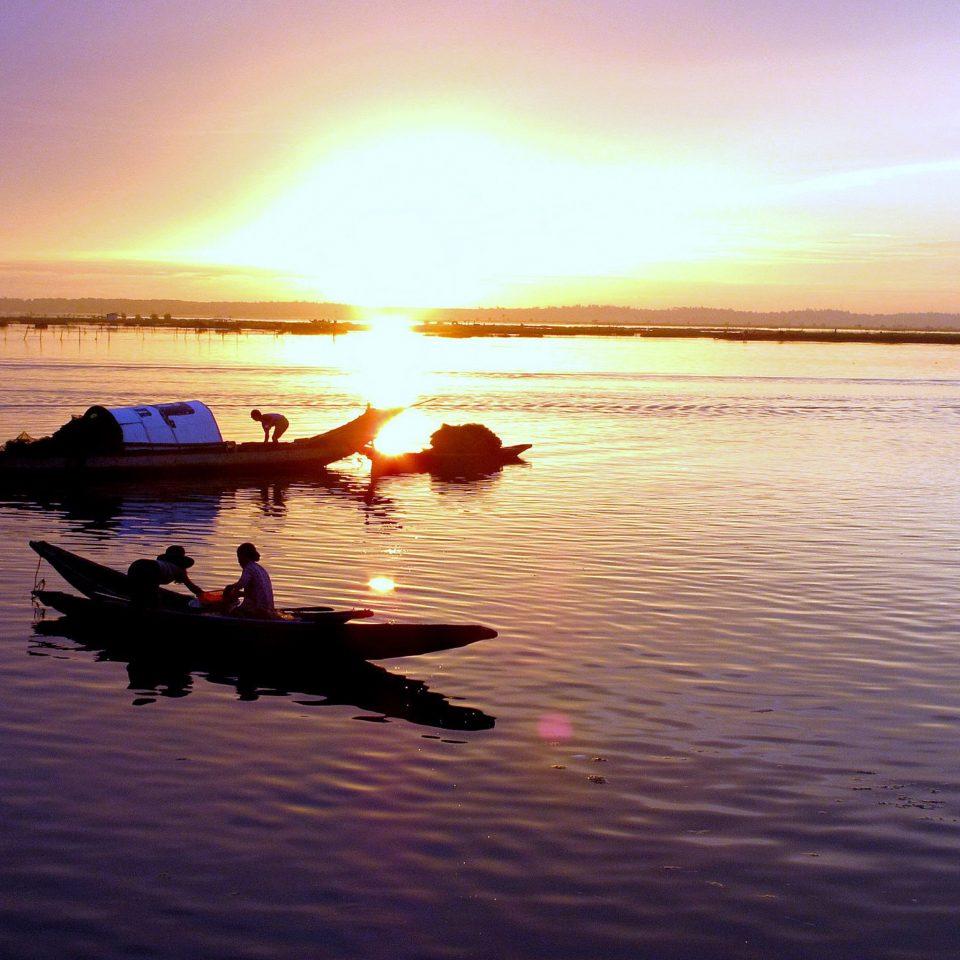 water sky Boat Sea horizon Sunset sunrise Ocean dawn morning vehicle shore dusk evening Coast Beach wave boating