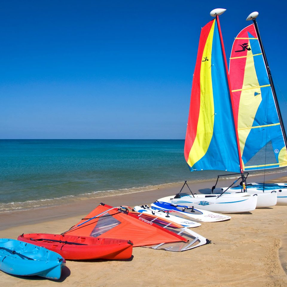 sky Beach color ground Sea blue sailboat Boat sail Ocean watercraft vehicle sailing sand Coast wind windsurfing wave colorful sandy shore colored