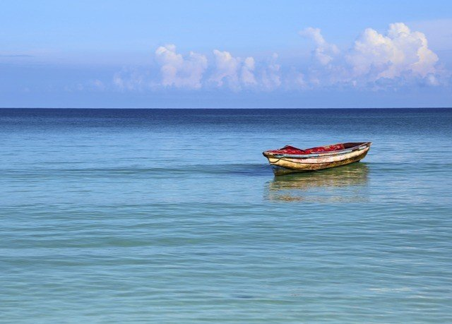 water sky shore Sea Boat vehicle Ocean long tail boat horizon boating watercraft rowing Coast watercraft Beach wave