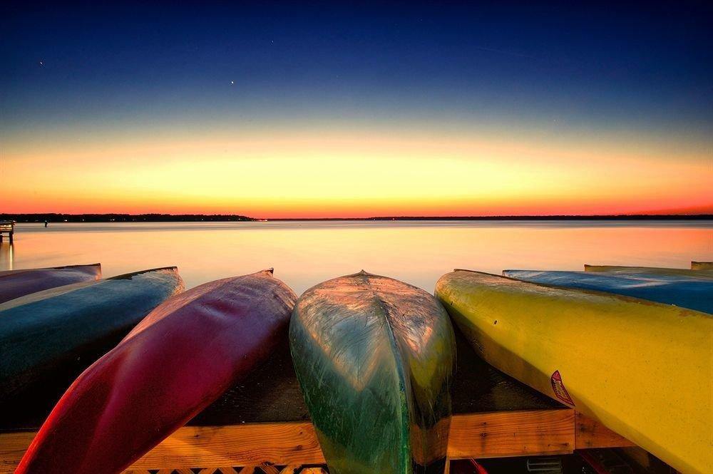 sky water Boat Sea Beach horizon Ocean vehicle Sunset evening sunrise dusk boating watercraft wooden Coast kayak surfing equipment and supplies paddle dawn set shore
