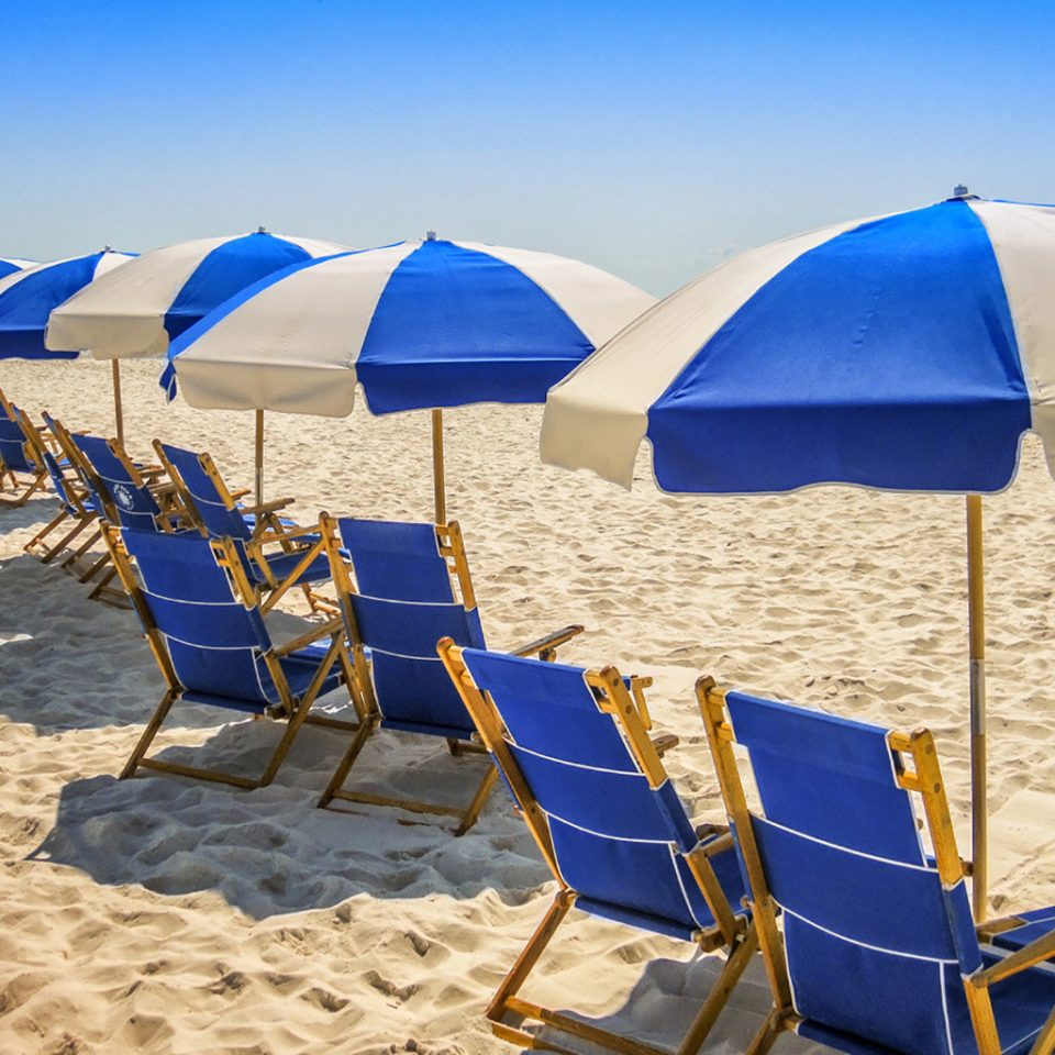 umbrella chair ground Beach blue Sea Ocean lawn fashion accessory sand wind Coast vehicle set day shore accessory lined Boat shade