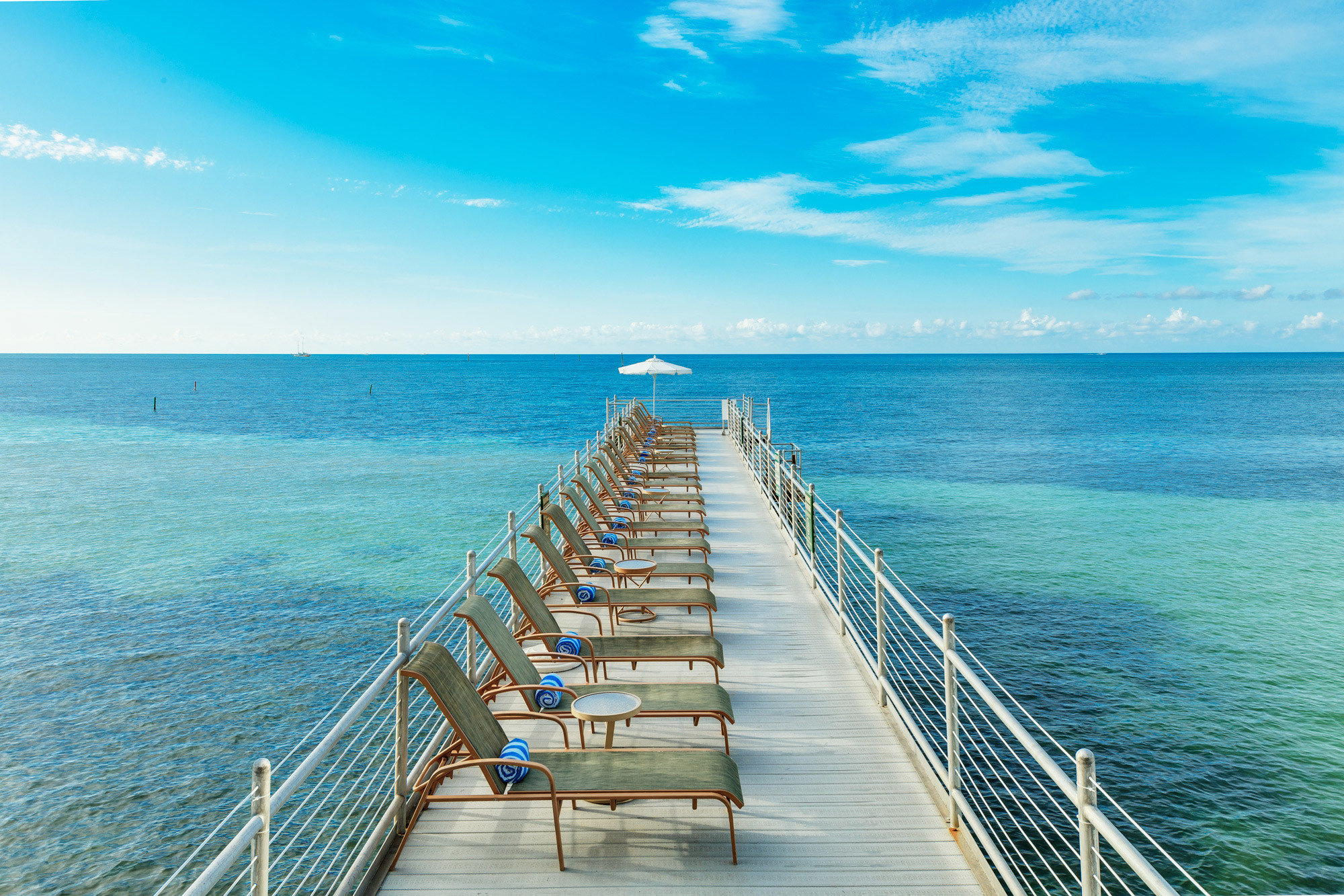 water sky Boat Sea horizon Ocean pier caribbean shore scene Coast Beach cape distance