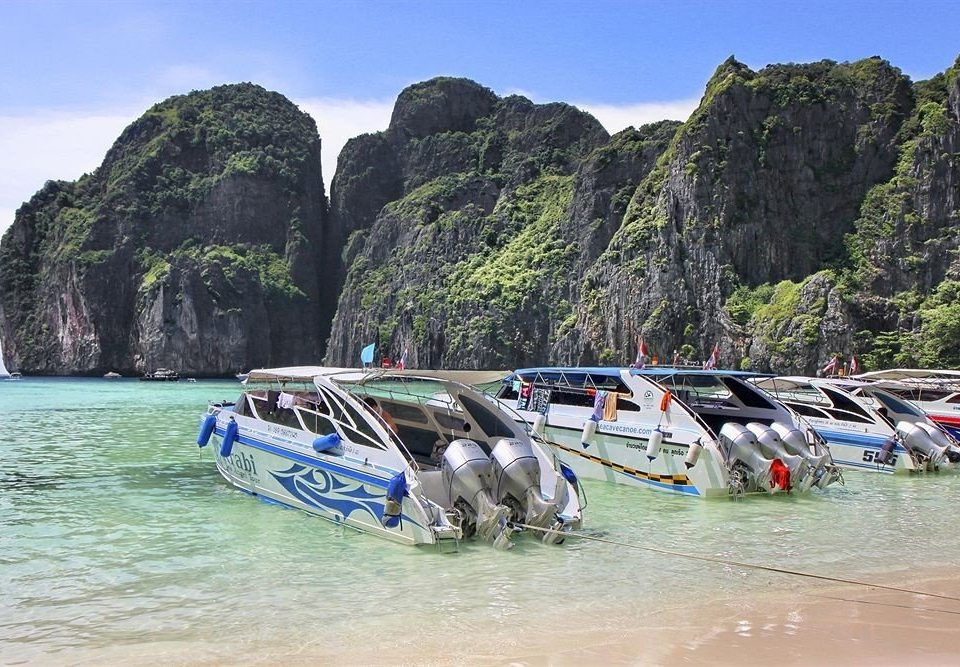 water Boat mountain Coast vehicle Sea Beach boating shore Raft