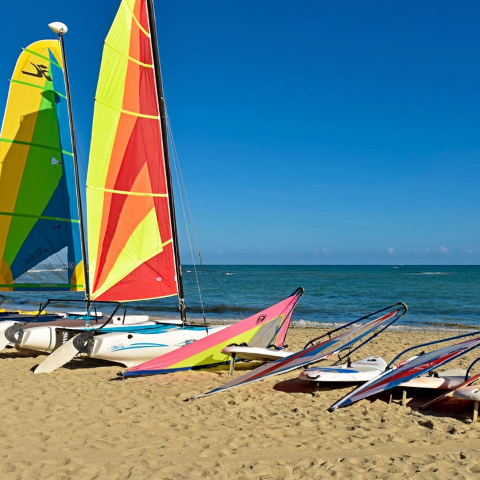 sky Beach water Boat sail sailboat Sea windsurfing sailing sand watercraft vehicle dinghy sailing sports transport wind Coast sailing ship dinghy sandy colorful colored