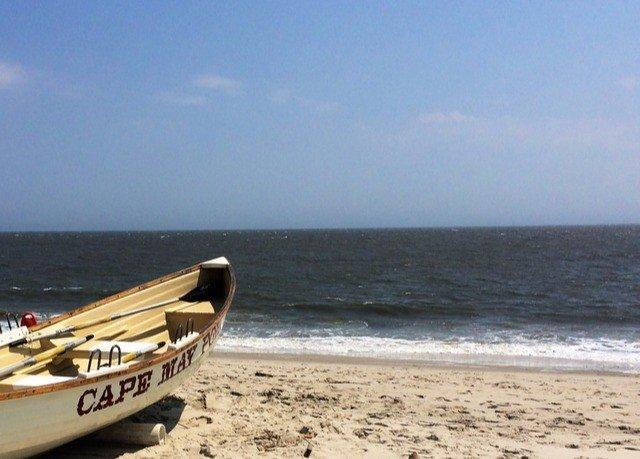 sky water Beach shore Sea vehicle Coast watercraft Boat watercraft rowing transport wind wave sandy
