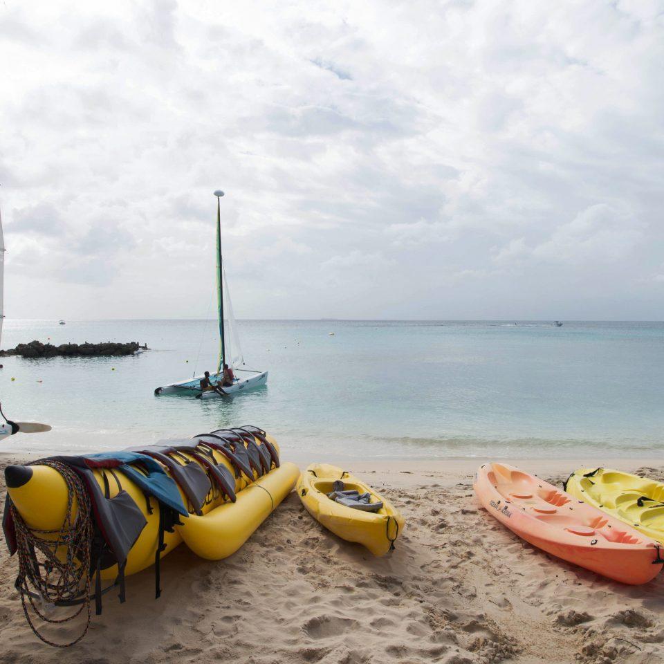 sky water watercraft Boat vehicle transport Sea boating sailing vessel sail Beach sailing kayak Coast sailboat windsurfing paddle sandy day