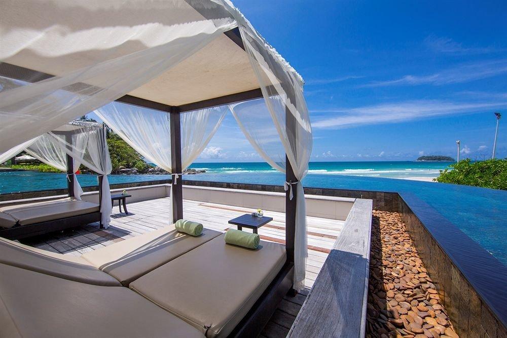 sky water chair property Beach Ocean caribbean Villa Resort vehicle swimming pool overlooking yacht Sea Boat Lagoon shore Deck Island sandy