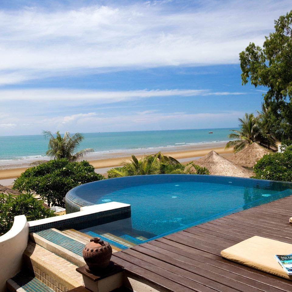 Deck Lounge Luxury Modern Pool sky tree water swimming pool property leisure Villa Resort Ocean Sea caribbean home backyard Beach overlooking lined Boat