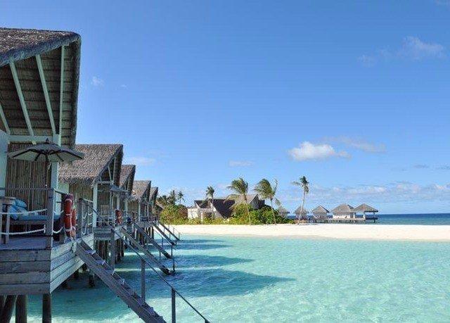 sky water property Boat leisure Resort swimming pool caribbean dock Beach Sea shore Deck