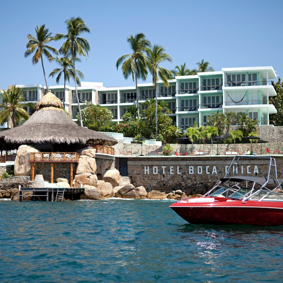Exterior Grounds Hip Resort Waterfront water Boat sky building Sea vehicle marina Beach dock docked caribbean boating