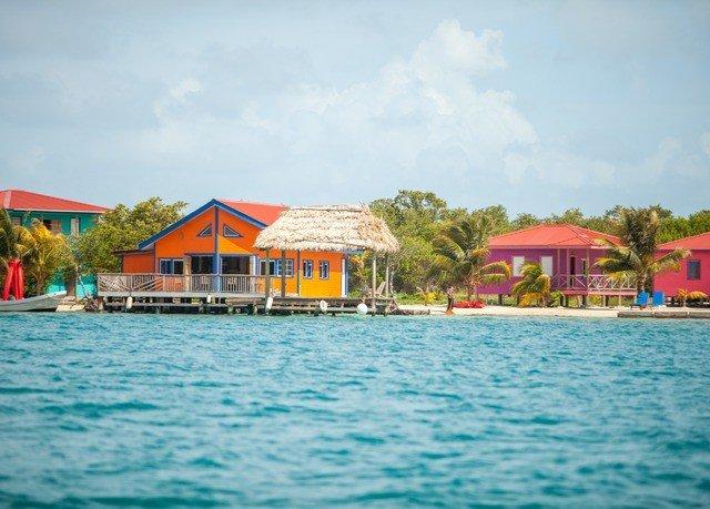 water sky leisure house Boat Resort swimming pool Beach resort town caribbean Lagoon Lake Sea Island shore colored