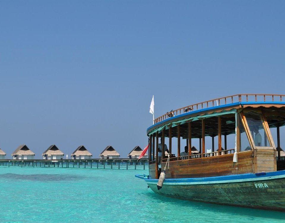 sky water Boat Sea vehicle blue Beach Ocean Resort caribbean Island swimming