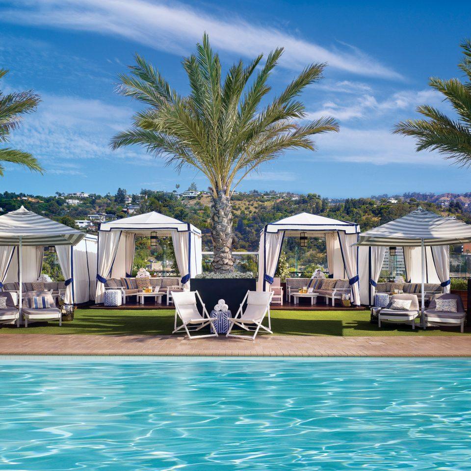 Lounge Luxury Pool Tropical tree water swimming pool leisure property Resort caribbean home Villa Sea Beach Lagoon arecales condominium blue swimming Boat