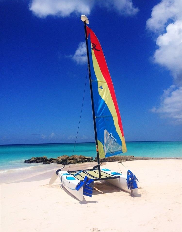 sky Beach water sailboat Boat sail watercraft vehicle Sea caribbean transport dinghy sailing blue sailing catamaran wind Lagoon sailing vessel mast shore flag day sandy
