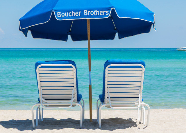 chair umbrella water accessory sky Beach blue Ocean leisure lawn shore product fashion accessory empty Boat set day shade sandy