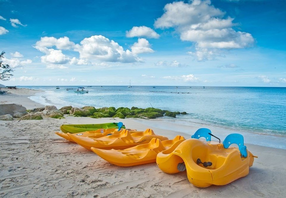 sky water Beach Sea shore Boat boating Ocean vehicle caribbean orange kayak surfing equipment and supplies sandy