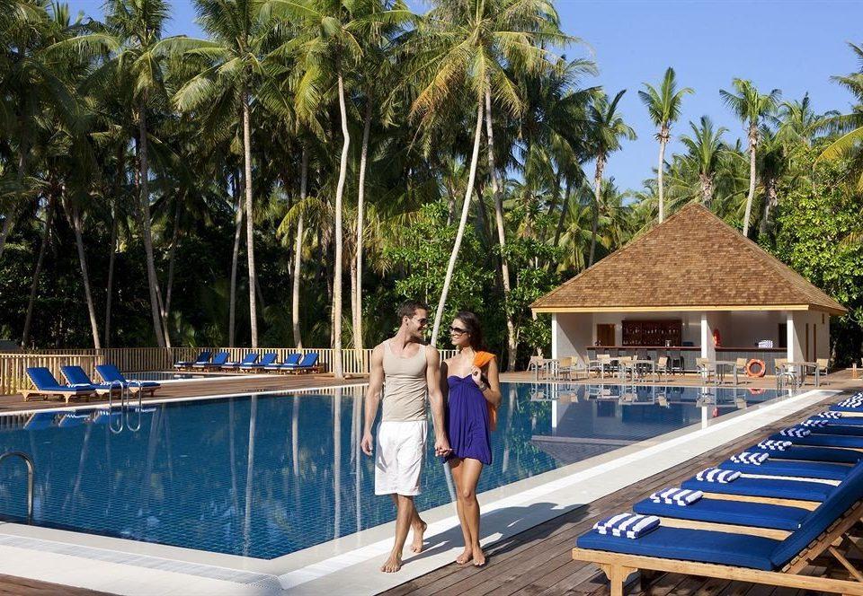 tree sky ground leisure swimming pool Resort caribbean Beach Sea walkway dock arecales Boat