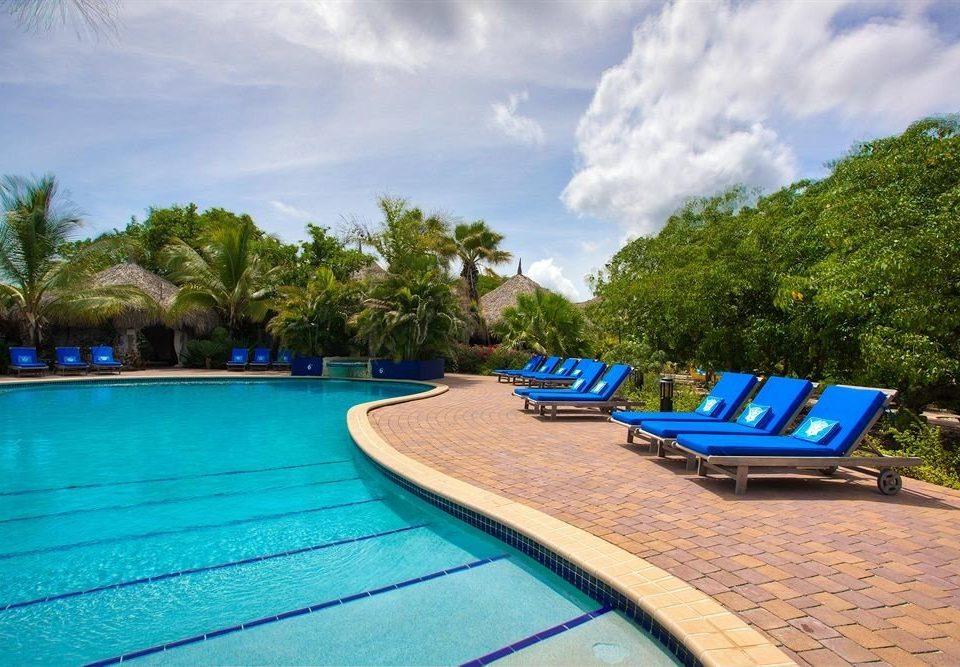 sky ground tree blue swimming pool leisure Beach Resort caribbean Villa Water park backyard Boat day sandy
