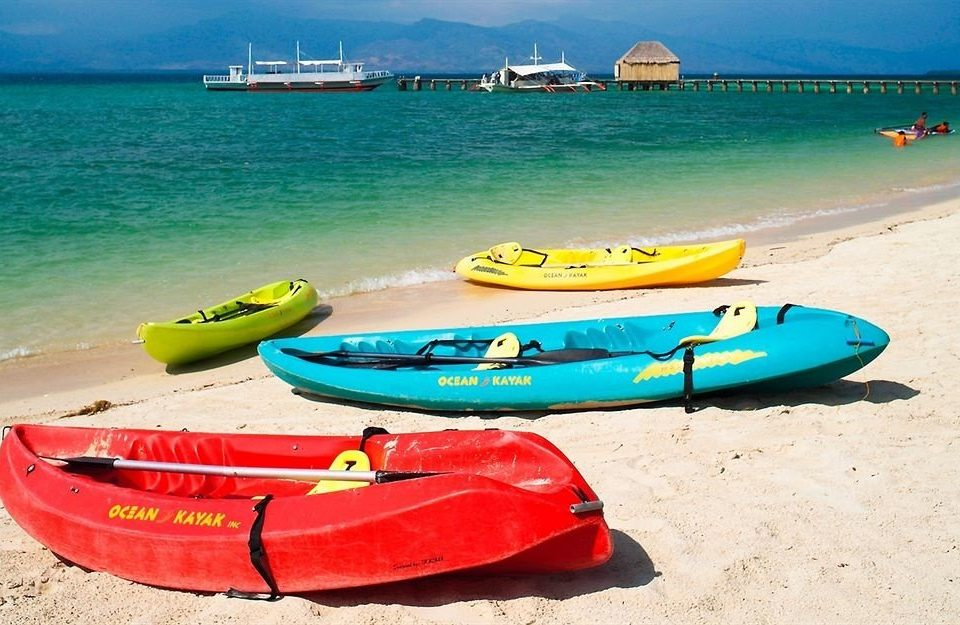 sky ground Boat water sea kayak vehicle kayak Beach boating kayaking watercraft watercraft rowing surfboard sports equipment surfing equipment and supplies Sea paddle dinghy sand colored