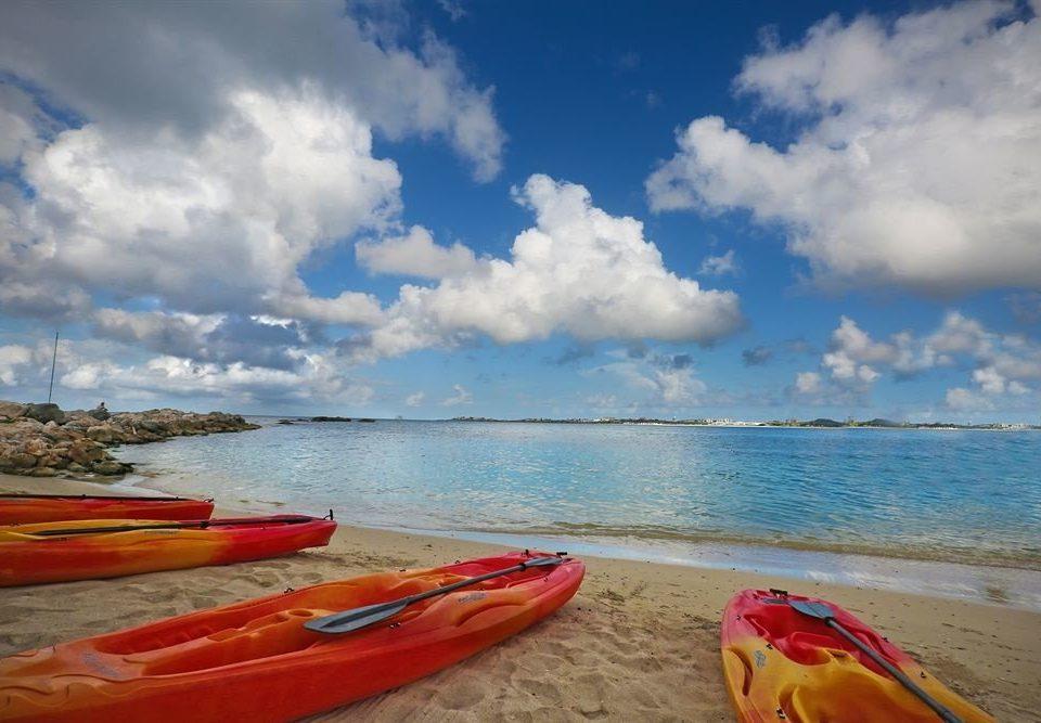 sky water Boat vehicle kayak Beach sea kayak kayaking Sea boating watercraft sports equipment wind wave paddle cloudy clouds sandy